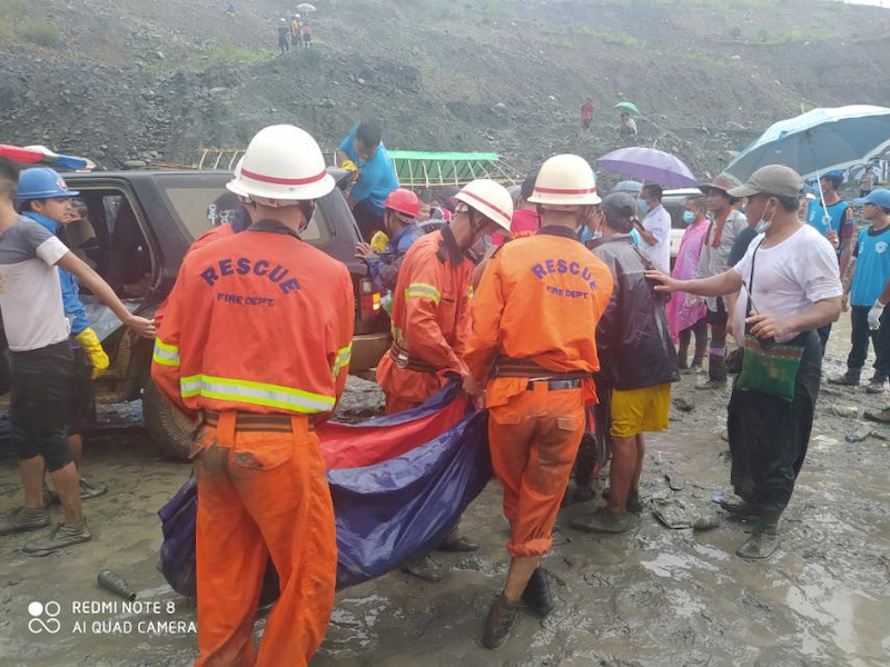 Rescue workers carry a dead body following a landslide at a mining site in Hpakant, Kachin State City, Myanmar July 2, 2020, in this picture obtained from social media. — Myanmar Fire Department handout via Reuters