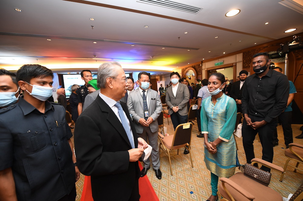 Pavithra and Sugu meeting Prime Minister Tan Sri Muhyiddin Yassin in Putrajaya. — Bernama pic