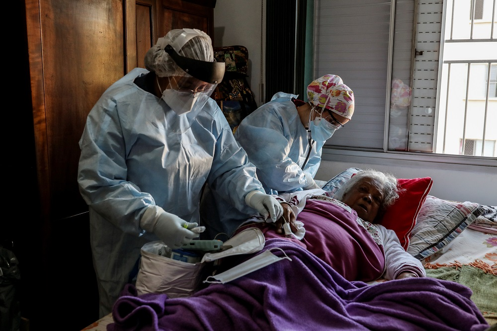 Emergency Rescue Service nurses attend to a patient who is experiencing breathing difficulty and others symptoms of the coronavirus disease (Covid-19) amid the outbreak, in Sao Paulo July 2, 2020. — Reuters pic