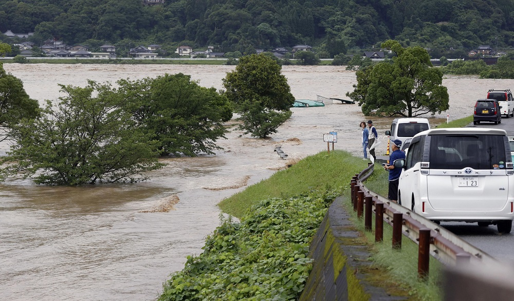 Rising water caused by a heavy rain is seen along Kuma river in Yatsushiro, Kumamoto prefecture, southern Japan July 4, 2020. — Picture by Kyodo via Reuters