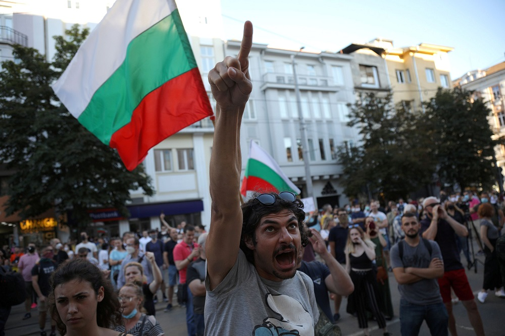 A man shout slogans during a demonstration in front of the Court of Justice after prosecutors raided the Bulgarian president's offices as part of investigations, in Sofia,  Bulgaria July 9, 2020. — Reuters pic