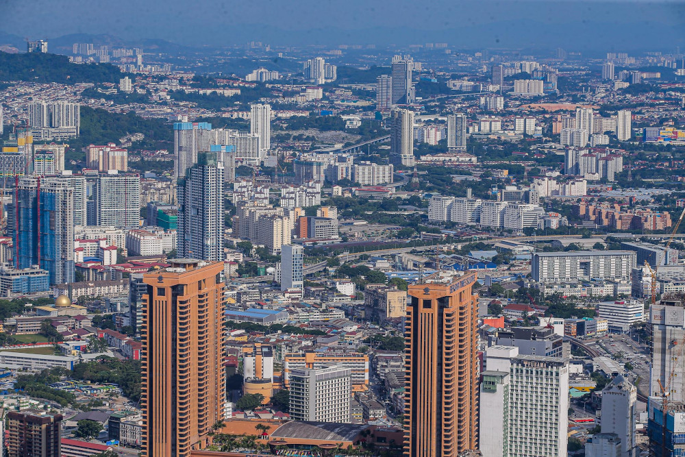 A bird's-eye view of Kuala Lumpur July 8, 2020. Tengku Zafrul said he did not want to see GLCs and GLICs slowing down their investments in view of the current economic conditions. — Picture by Hari Anggara