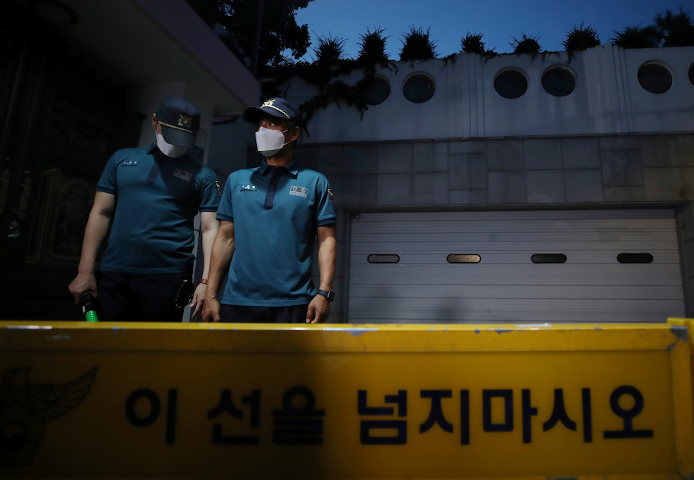 South Korean policemen stand guard in front of Seoul Mayor Park Won-soon's residence in Seoul, South Korea, July 9, 2020. — Reuters pic
