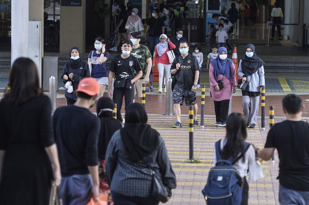 People wearing face masks are pictured at a shopping mall in Petaling Jaya July 11, 2020. — Picture by Miera Zulyana