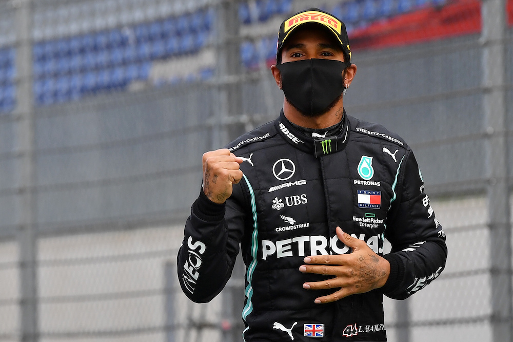 2020 Mercedes' Lewis Hamilton wears a protective face mask as he celebrates winning the race, following the resumption of F1 after the outbreak of the coronavirus disease (Covid-19)m Styria, Austria - July 12, 2020. — Reuters pic