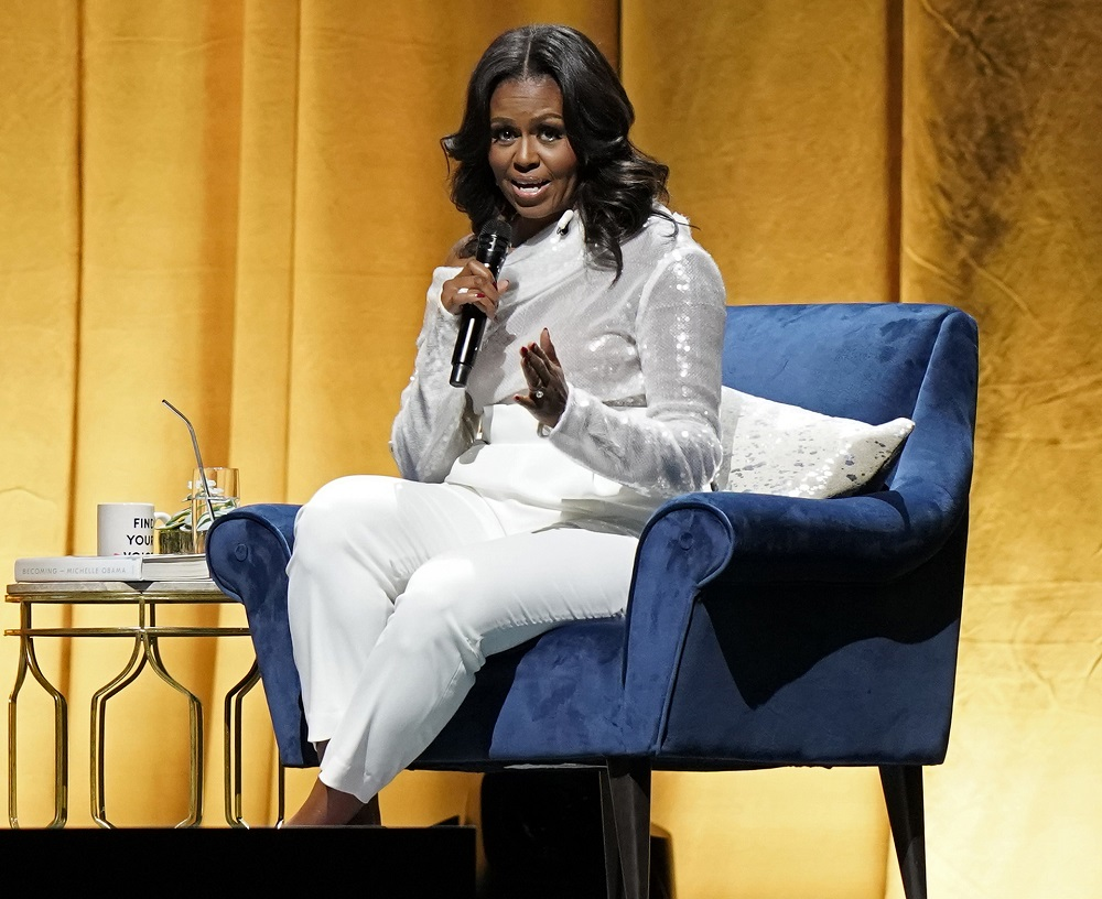 Former US first lady Michelle Obama will debut as a podcaster on Spotify. — AFP pic