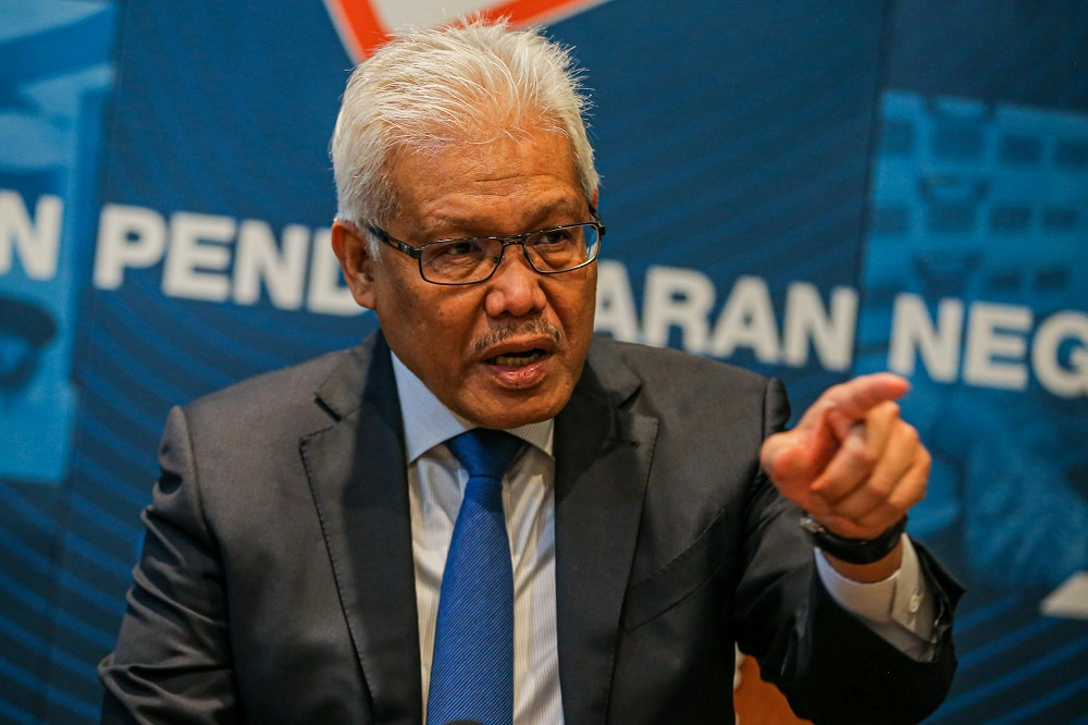 Home Minister Datuk Seri Hamzah Zainudin speaks to reporters at a press conference at the National Registration Department in Putrajaya July 20, 2020. — Picture by Hari Anggara