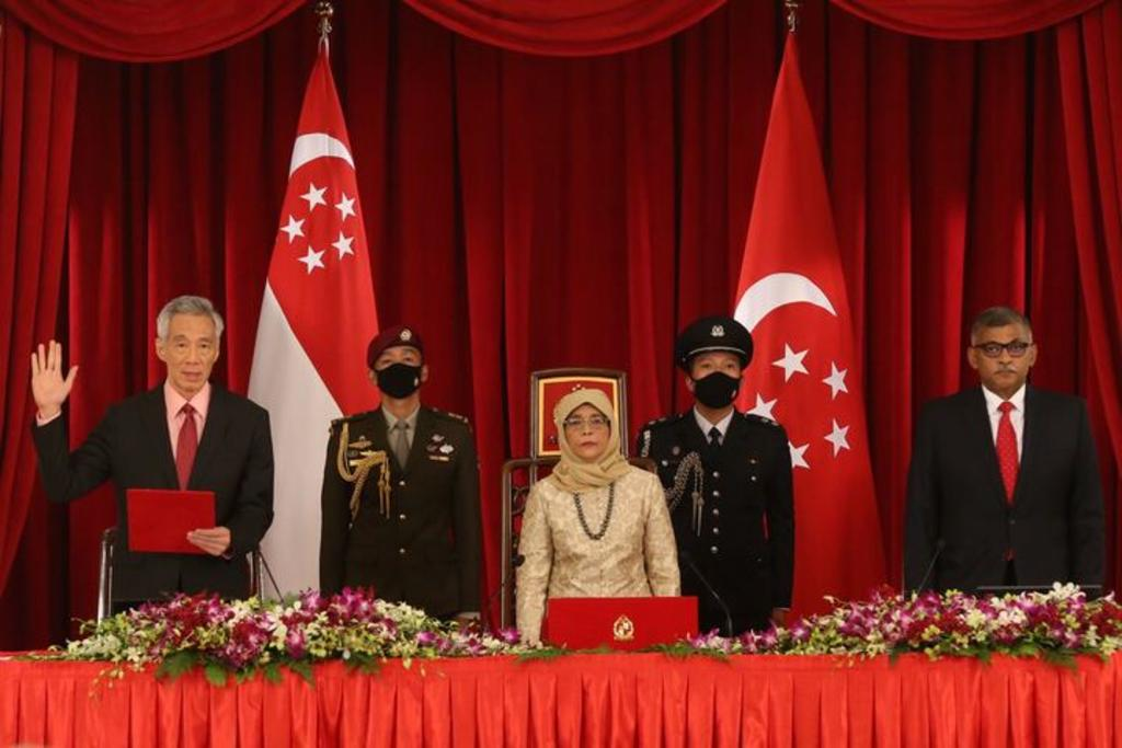 Prime Minister Lee Hsien Loong (left), President Halimah Yacob (centre) and Chief Justice Sundaresh Menon (right) at the swearing in of the new Cabinet on July 27, 2020. — TODAY pic