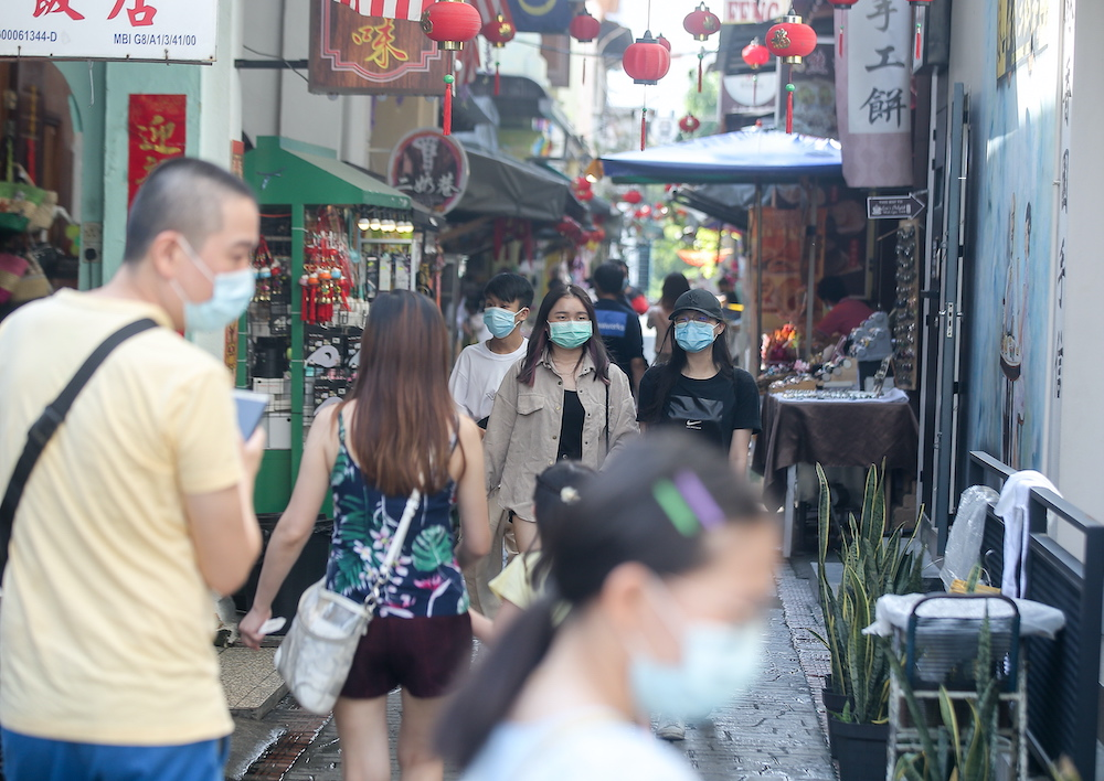 File picture showing tourists at Ipoh's Concubine Lane. Malaysian Association of Tour and Travel Agent president Datuk Tan Kok Liang said that implementation of the second CMCO is demoralising as domestic tourism was just starting to pick up.  — Picture by Farhan Najib