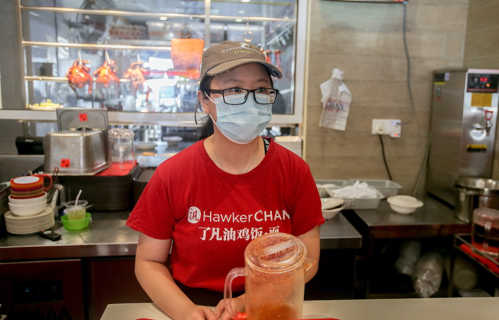 Michelin star Singapore-based Liao Fan Hawker Chan's chicken rice shop supervisor Wyng Yap, 30, says they have seen more local tourists now after the lockdown eased. — Picture by Farhan Najib
