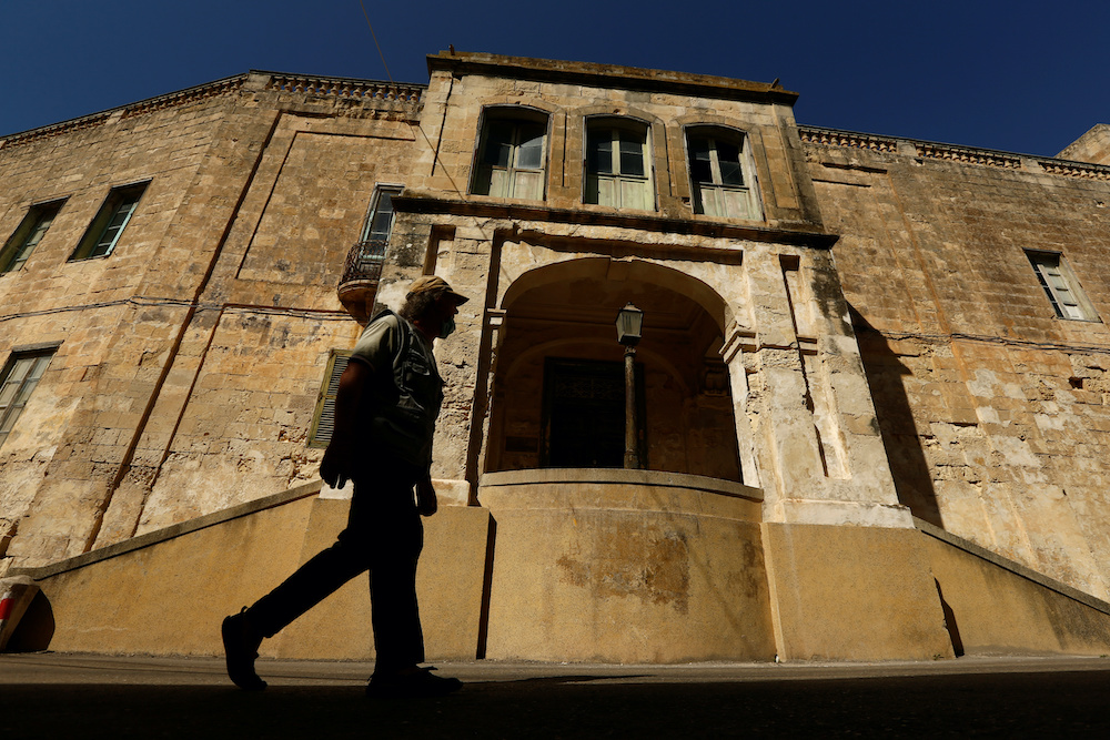 A man walks past the main entrance of Villa Guardamangia, a former residence of Britain's Queen Elizabeth and Prince Philip, in Pieta, Malta, July 1, 2020. — Reuters pic
