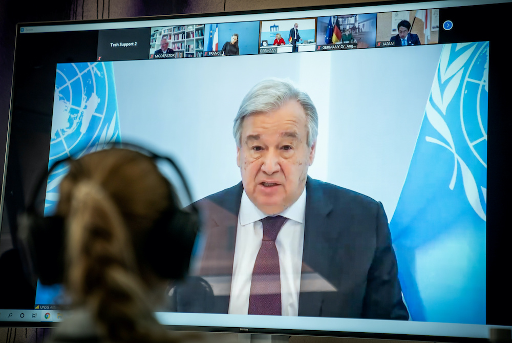 United Nations Secretary-General Antonio Guterres is seen on a video screen during a virtual climate summit, known as the Petersberg Climate Dialogue, in Berlin on April 28, 2020. — Reuters pic