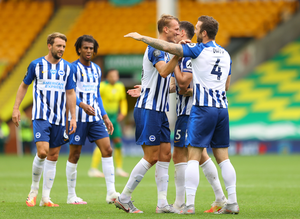 Brighton & Hove Albion's Dan Burn and teammates celebrate after the match, as play resumes behind closed doors following the outbreak of the coronavirus disease against Norwich City at Carrow Road in Norwich, Britain, July 4, 2020. — Reuters pic