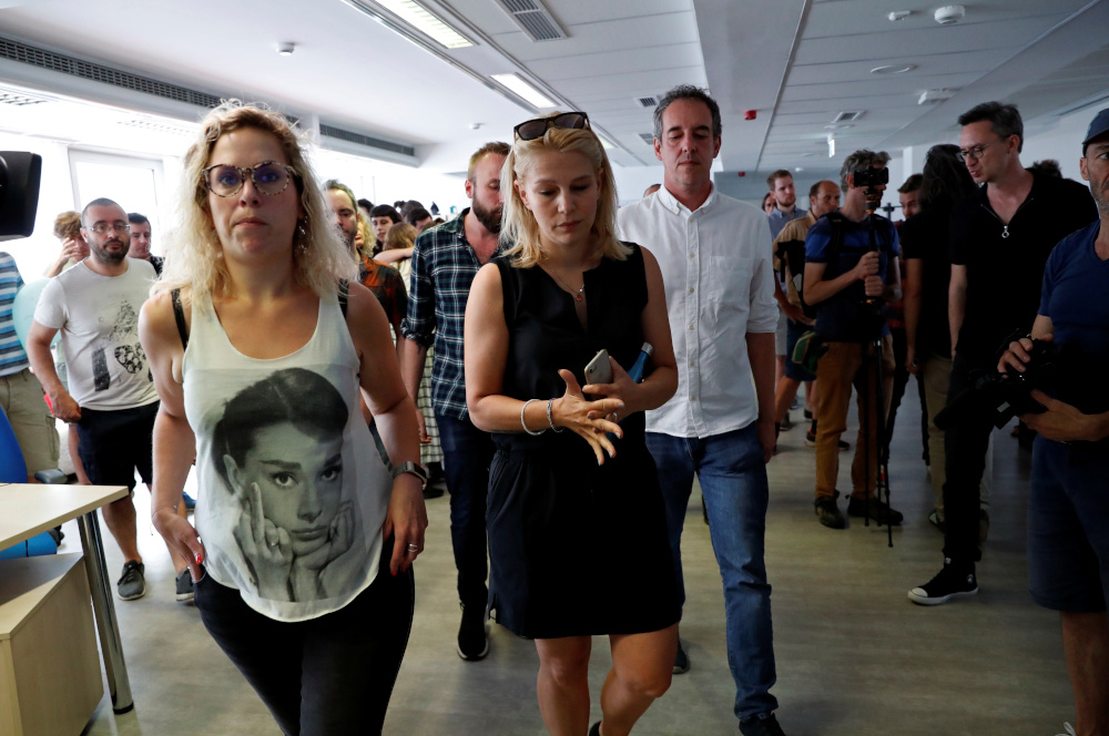Deputy editor in chief Veronika Munk and employees of Hungary's main independent news website 'Index' leave the newsroom after they quit in Budapest, Hungary, July 24, 2020. — Reuters pic