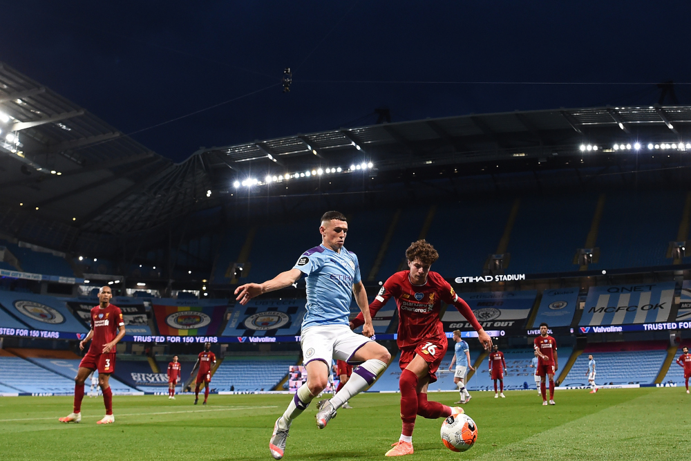 Manchester City's English midfielder Phil Foden vies with Liverpool's Welsh midfileder Neco Williams during the English Premier League football match between Manchester City and Liverpool at the Etihad Stadium in Manchester July 2, 2020. — AFP pic