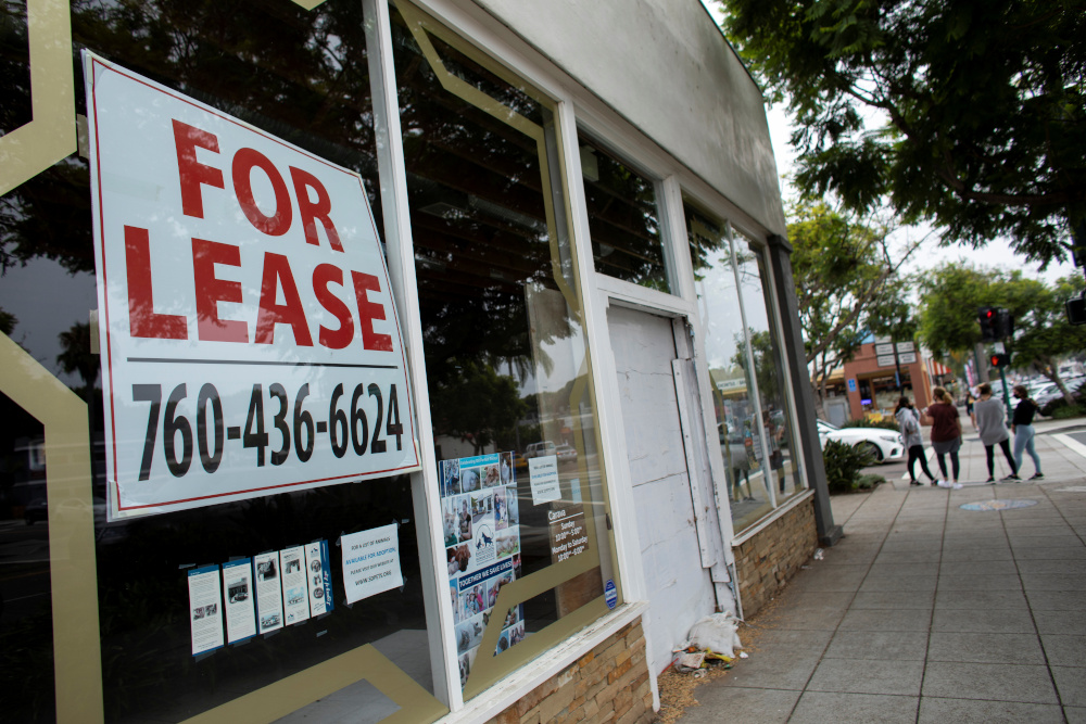 An empty retail store advertises on its window during the outbreak of the coronavirus disease in Encinitas, California, US, July 30, 2020. — Reuters pic