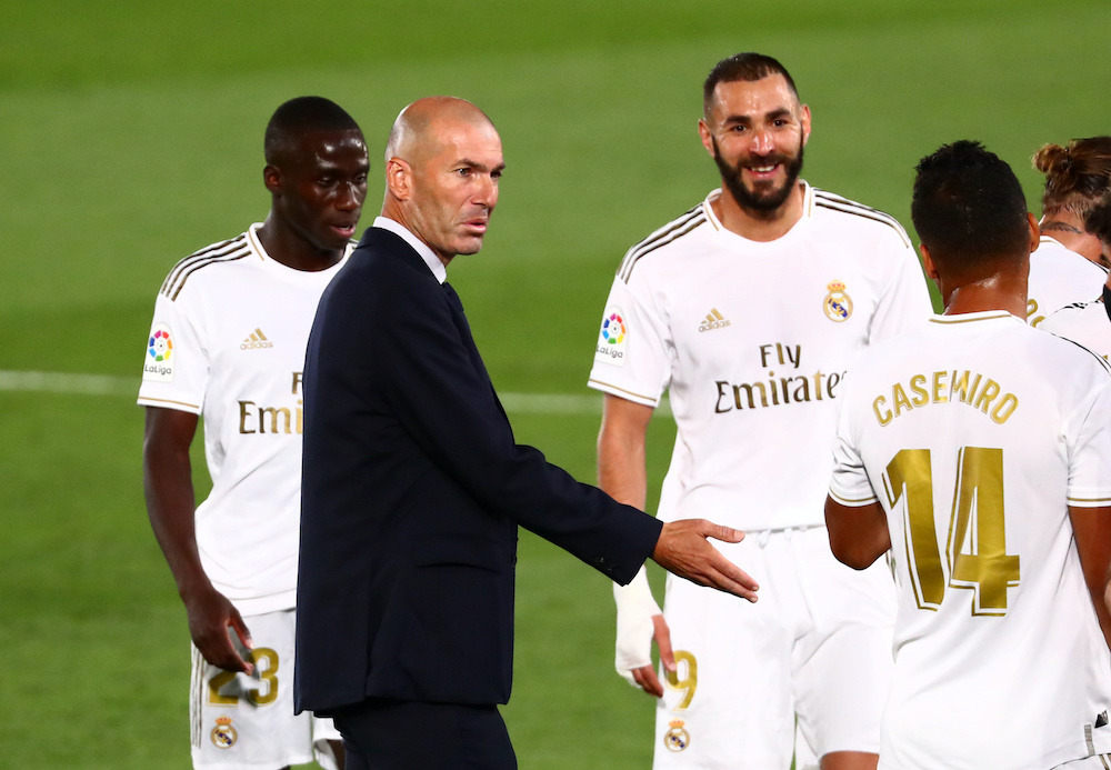 File photo of Real Madrid coach Zinedine Zidane with Karim Benzema and Casemiro, as play resumes behind closed doors against Getafe following the outbreak of the coronavirus disease at the Alfredo Di Stefano Stadium in Madrid, July 2, 2020. — Reuters pic