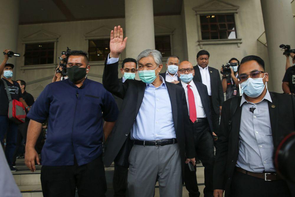 Umno president Datuk Seri Dr Ahmad Zahid Hamidi waves at supporters at the Kuala Lumpur High Court July 28, 2020. ― Picture by Yusof Mat Isa