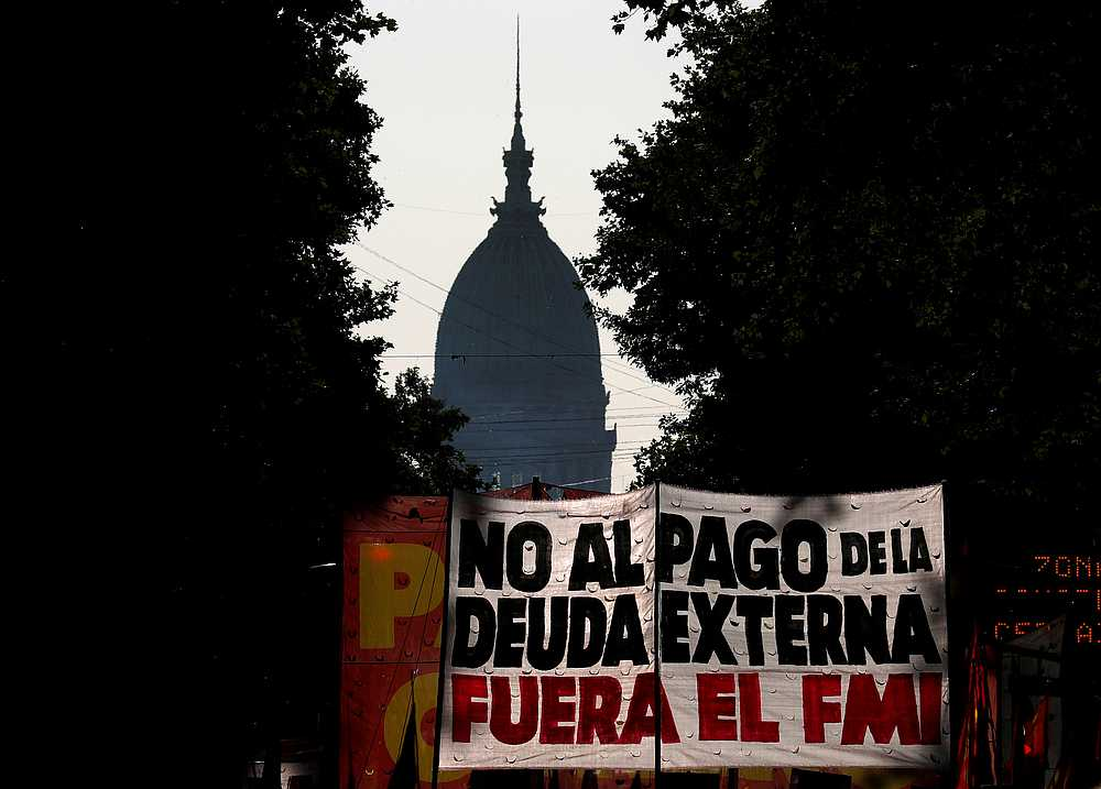 Demonstrators hold a banner that reads 'no to foreign debt payment, IMF out' as they march towards Casa Rosada Presidential Palace in Buenos Aires February 12, 2020. — Reuters pic