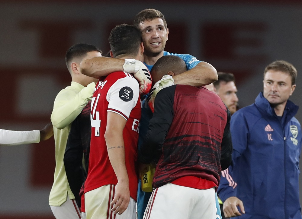 Arsenal's Emiliano Martinez celebrates with Granit Xhaka and Alexandre Lacazette after the match against Liverpool July 16, 2020. Aston Villa announced the signing of Martinez today for a reported fee of £20 million. ― Reuters pic