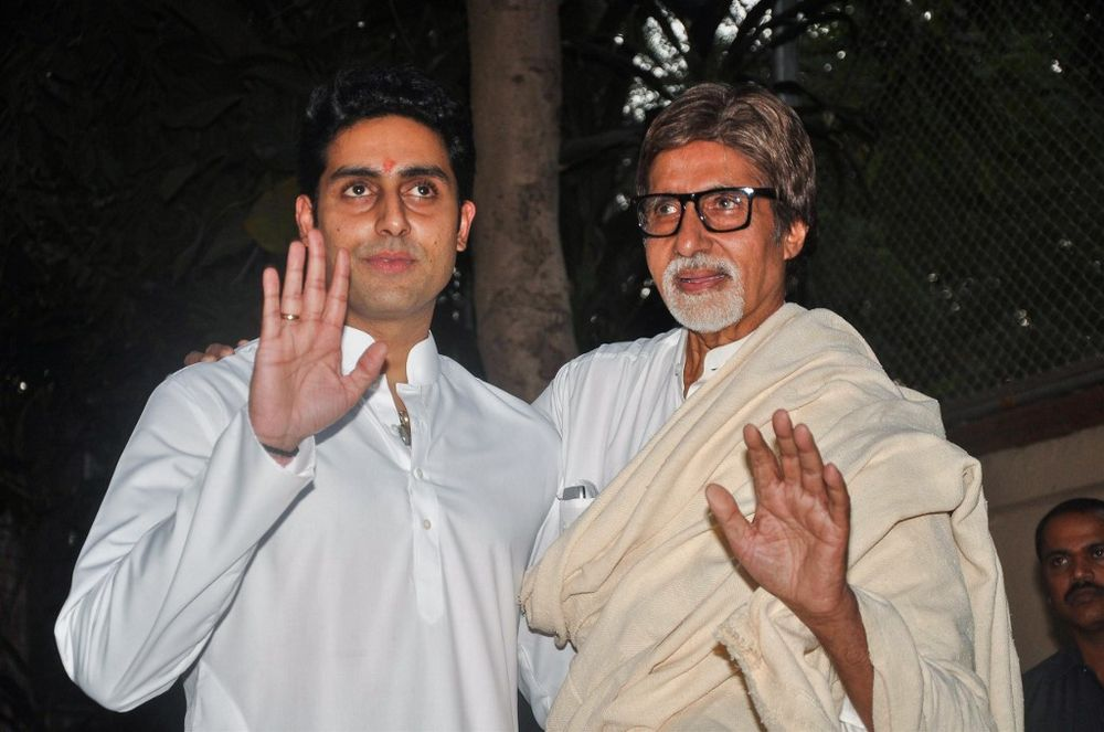 In this file photo taken on November 22, 2011 Bollywood actors Amitabh Bachhan (right) and his son Abhishek Bachchan hold a press conference about their new grand-daughter/daughter in Mumbai. — AFP pic