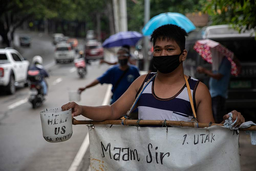 Jeepney drivers who lost livelihoods amid the Covid-19 outbreak beg for financial support on a roadside in Manila, Philippines July 30, 2020. — Reuters pic