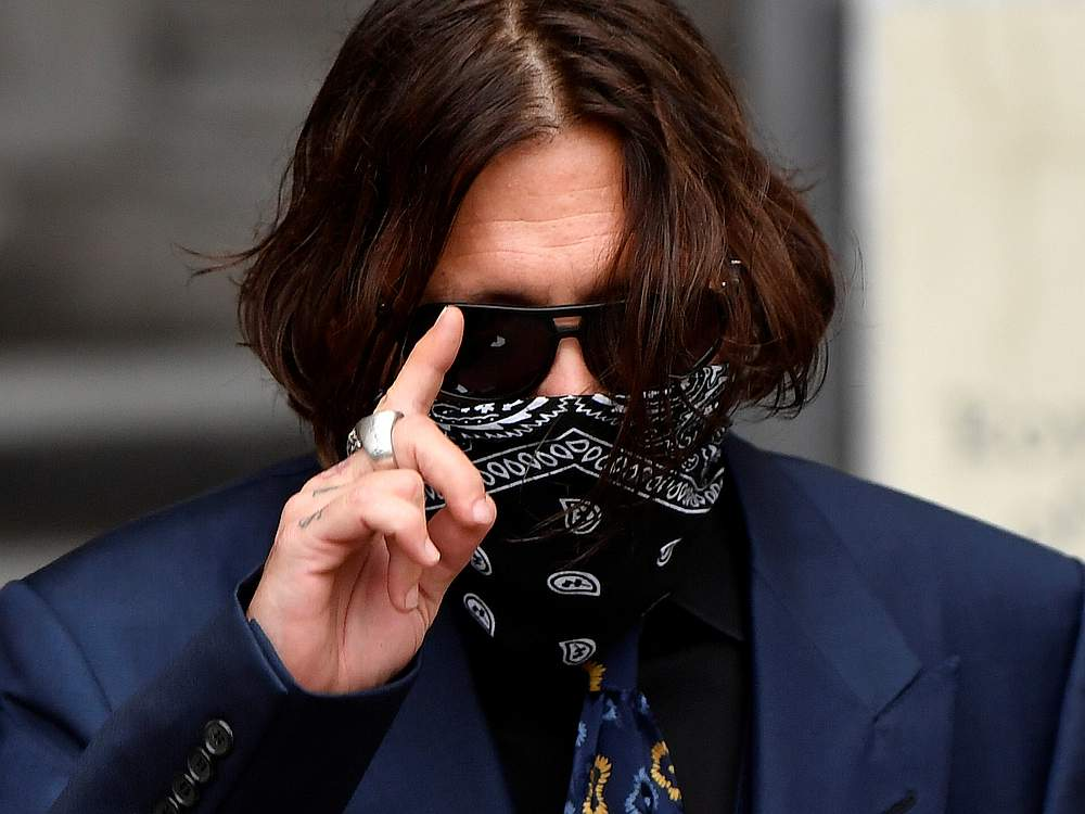 Actor Johnny Depp gestures arrives at the High Court in London July 9, 2020. — Reuters pic