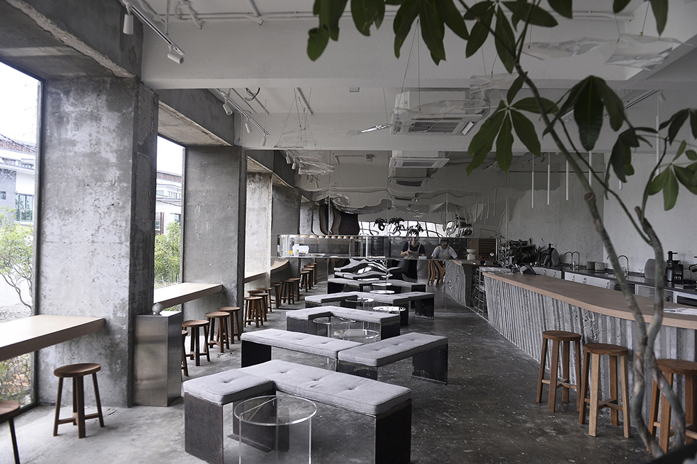The bakery's interior has a raw and natural palette.