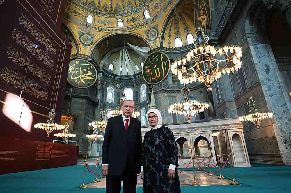 Turkey's President Tayyip Erdogan and his wife Emine Erdogan pose in the Hagia Sophia Grand Mosque in Istanbul, Turkey July 23, 2020. — PPO handout via Reuters