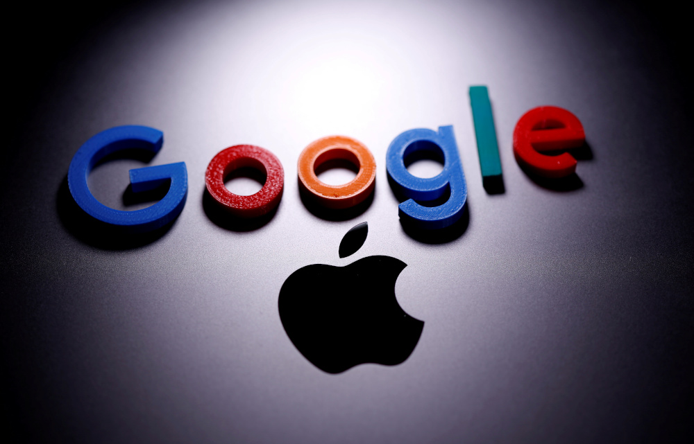 A 3D printed Google logo is placed on the Apple Macbook in this illustration taken April 12, 2020. — Reuters pic