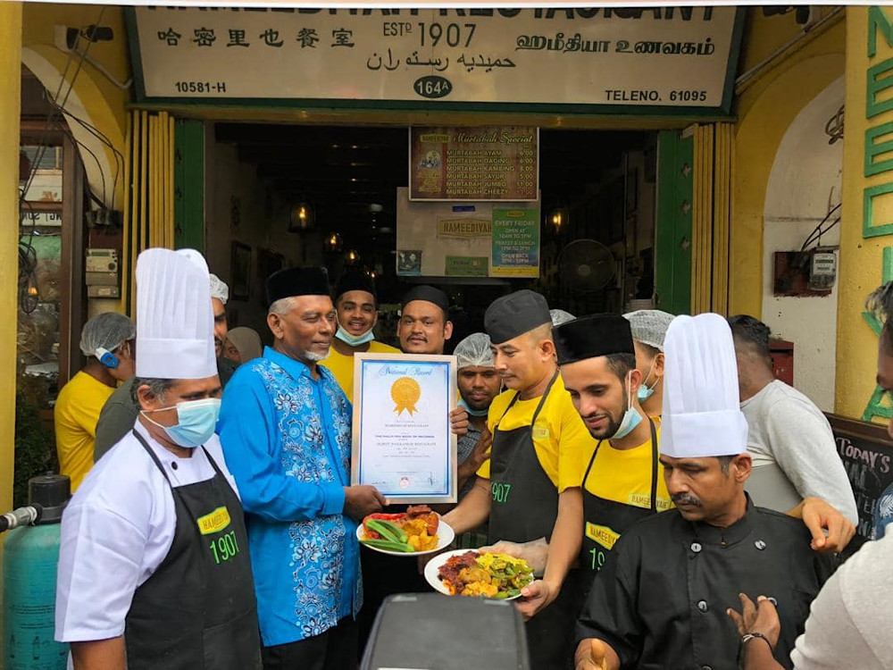 Penang's Hameediyah has claimed the title in the Malaysia Book of Records (MBR) of being the country's oldest nasi kandar restaurant. — Picture from Facebook/Hameediyah Restaurant