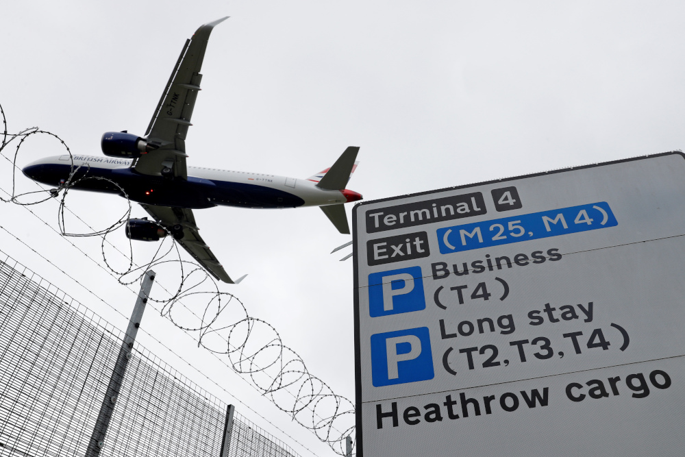 In this file photo taken May 10, 2020, a British Airways passenger jet comes in to land at London Heathrow Airport in west London. Heathrow last year had 22 million passengers compared with 81 million in 2019. — AFP pic