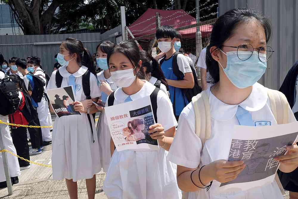 Secondary school students in a protest march near a school campus in Hong Kong, China June 12, 2020. — Reuters pic