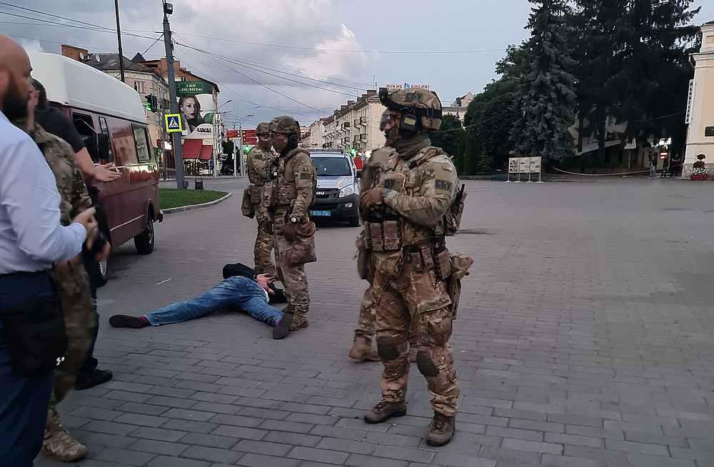 A suspected hostage-taker lies on the pavement in Lutsk, Ukraine July 21, 2020. — Ukrainian Interior Ministry handout via  Reuters