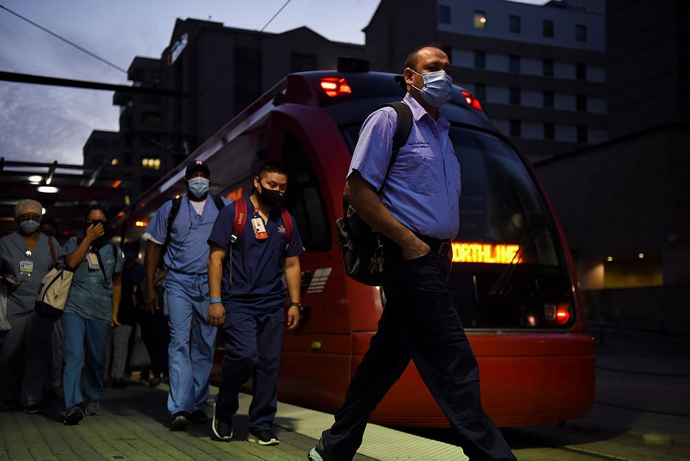 Healthcare workers walk through the Texas Medical Center during a shift change as cases of Covid-19 spike in Houston, Texas July 8, 2020. — Reuters pic