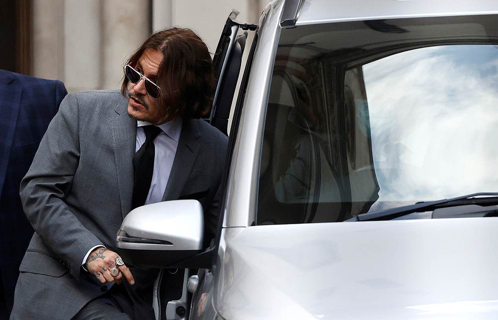 Actor Johnny Depp leaves the High Court in London, Britain July 13, 2020. — Reuters pic