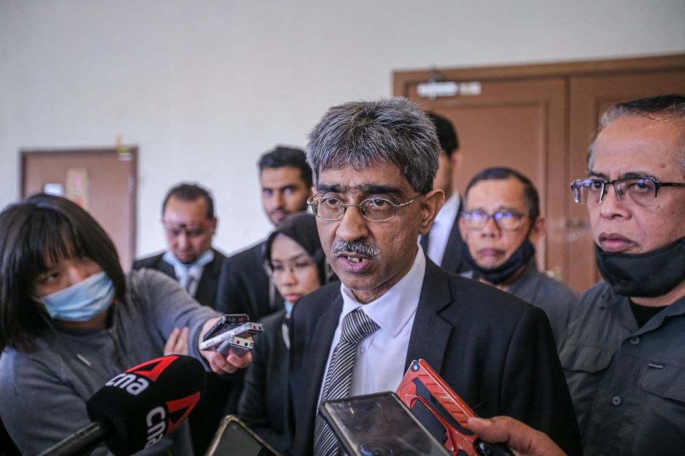Lawyer Mohamed Haniff Khatri Abdulla speaks to reporters at the Kuala Lumpur High Court July 9, 2020. — Picture by Hari Anggara