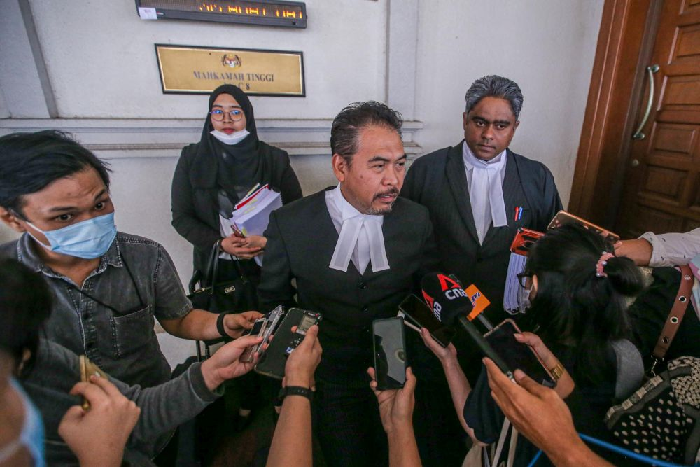 Lawyer Rosli Dahlan speaks to reporters at the Kuala Lumpur High Court July 9, 2020. — Picture by Hari Anggara