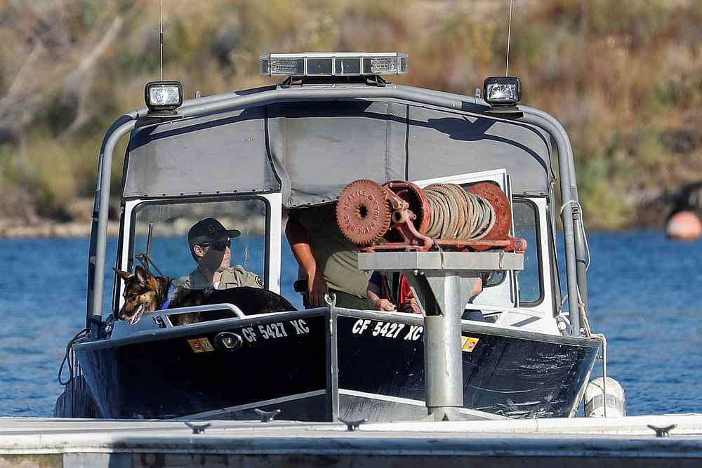 Members of a search and rescue team with a dog are seen on a boat during the search for missing actor Naya Rivera on Lake Piru, California July 9, 2020. — Reuters pic