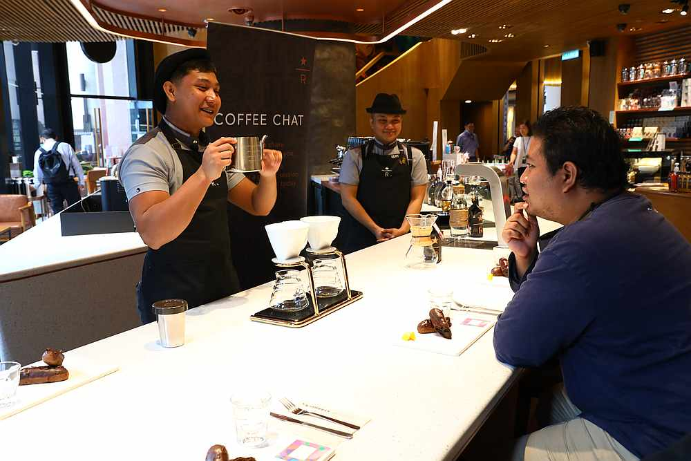 Luqman at the coffee chat session led by (from left) Syafiq Akmal and Remy Razali. — Picture courtesy of Starbucks Malaysia