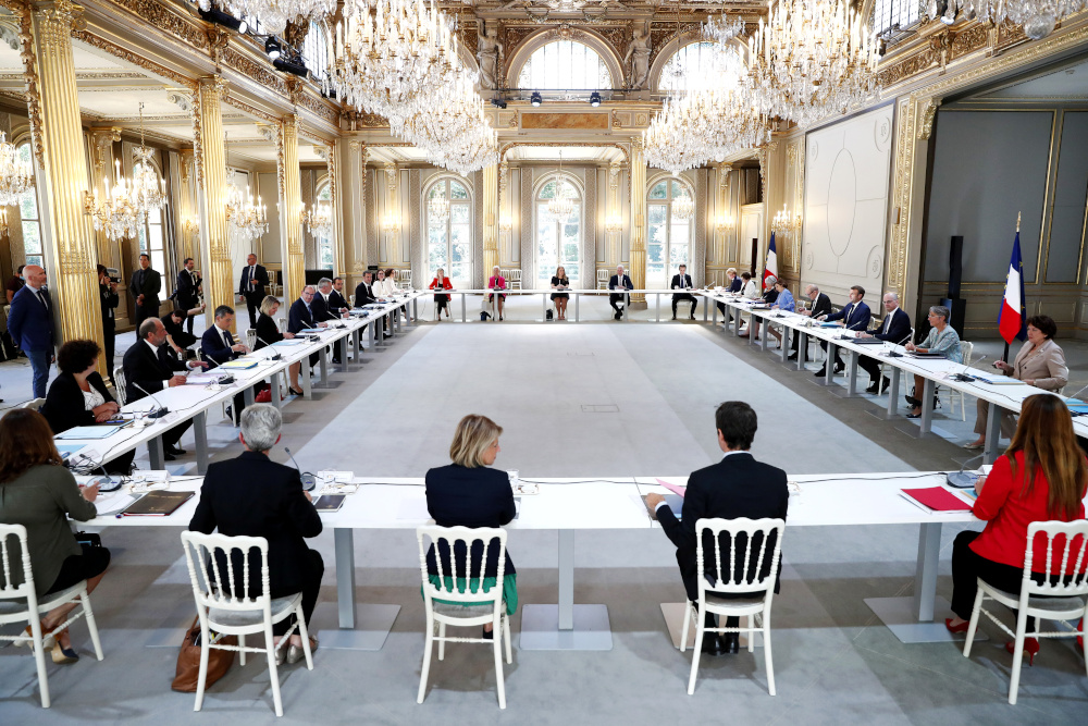 French President Emmanuel Macron, French Prime Minister Jean Castex and members of the new government attend their first minister council at the Elysee Palace in Paris, France, July 7, 2020. — Reuters pic