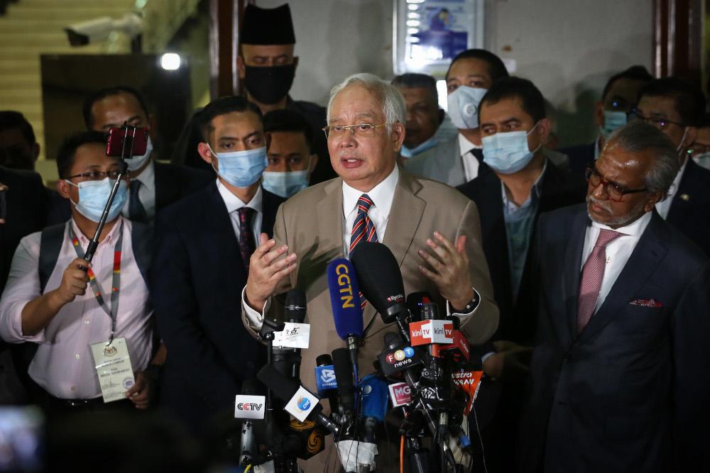 Datuk Seri Najib Razak speaks to reporters at the Kuala Lumpur High Court lobby July 28, 2020. — Picture by Yusof Mat Isa