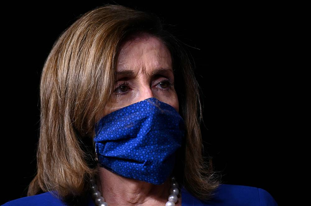 US House Speaker Nancy Pelosi listens during a news conference in the US Capitol in Washington July 29, 2020. — Reuters pic