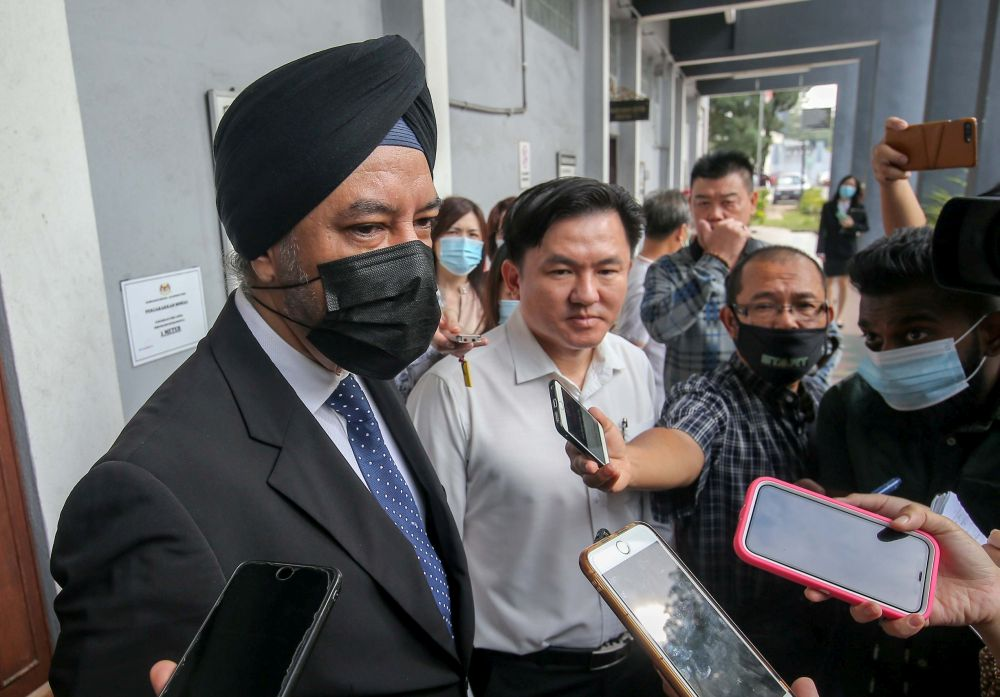 Lawyer Datuk Rajpal Singh speaks to members of the media at the Ipoh Sessions Court July 16, 2020. — Picture by Farhan Najib