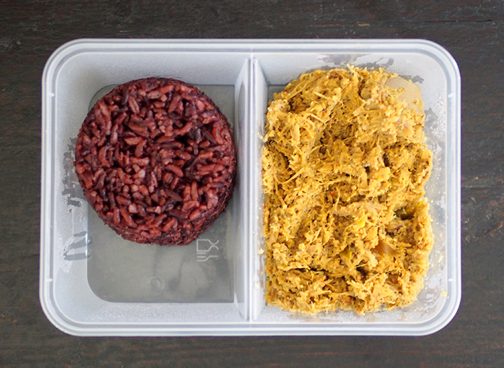 Your order is packed in a box with separate compartments for the black rice and duck brisket 'rendang'.