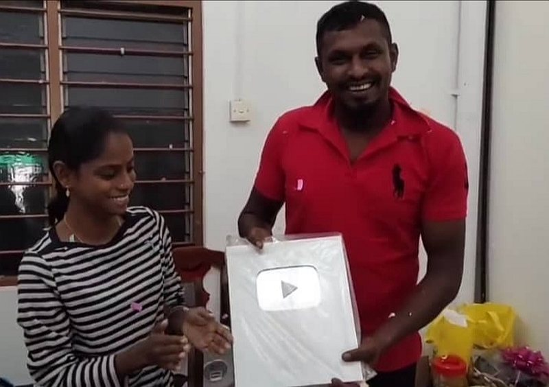 Pavithra and husband M. Sugu showing the Silver Play Button for surpassing 100,000 subscribers. — Screengrab from YouTube