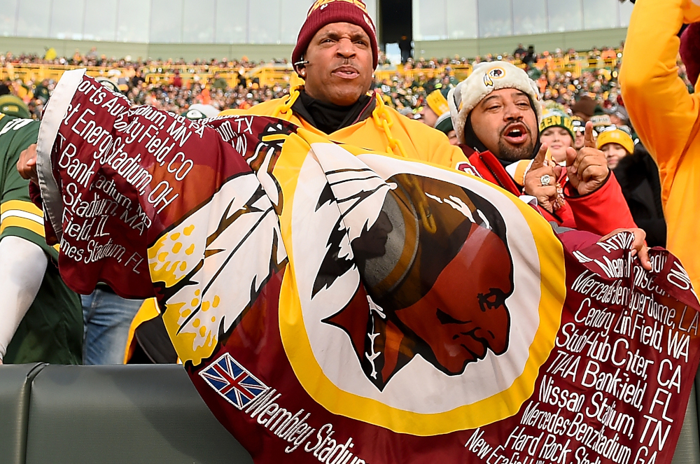 In this file photo taken December 8, 2019, a Washington Redskins fan unfurls a flag during the game against the Green Bay Packers at Lambeau Field in Green Bay, Wisconsin. — Stacy Revere/Getty Images North America pic via AFP