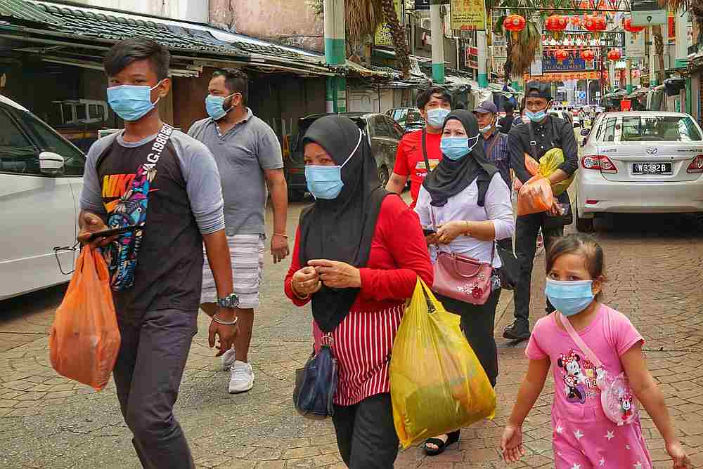 Members of the public wearing mask at Petaling Street amid the Covid-19 pandemic in Kuala Lumpur July 5, 2020. — Picture by Ahmad Zamzahuri