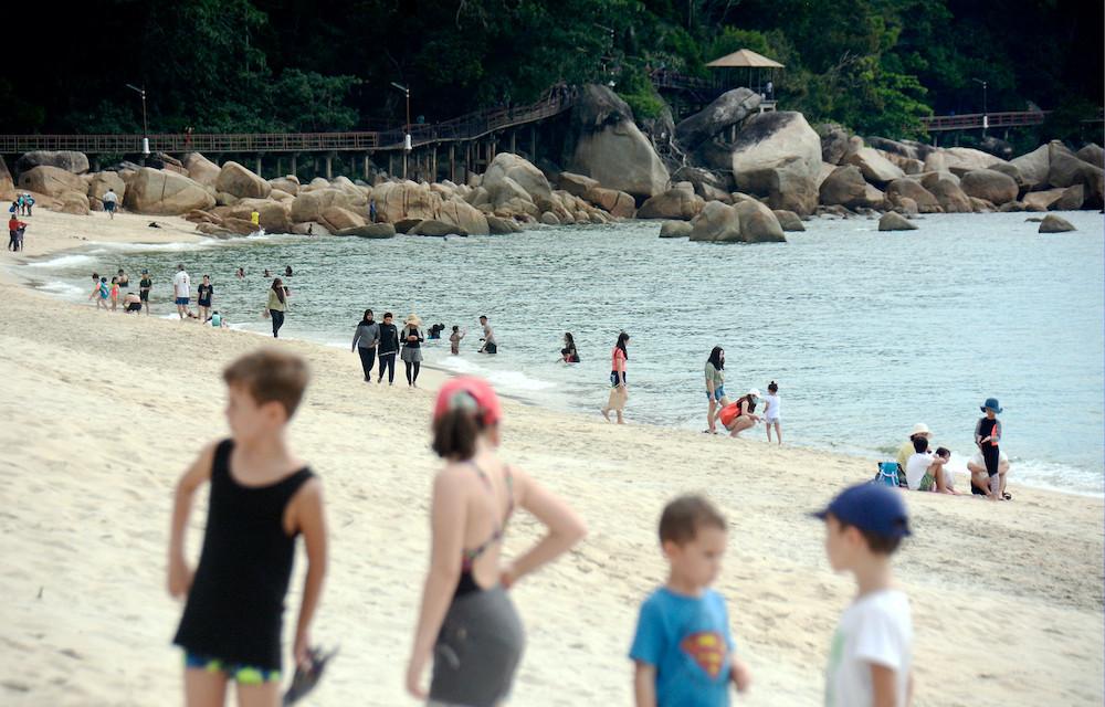 Visitors enjoying themselves at Teluk Cempedak, Kuantan July 12, 2020. — Bernama pic