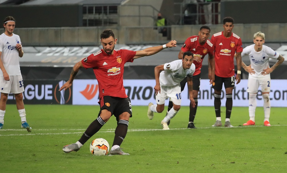 Manchester United's Bruno Fernandes scores their first goal from the penalty spot at the RheinEnergieStadion in Cologne August 10, 2020. — Reuters pic